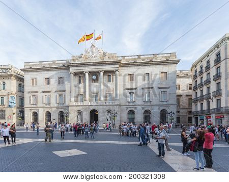 Barcelona - October 10 2015: Tourists walking in the square of the sitting of Jacob near Ajuntament de Barcelona October 10 2015 Barcelona Spain