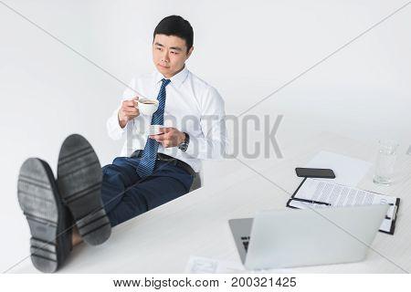 Asian Businessman Drinking Coffee