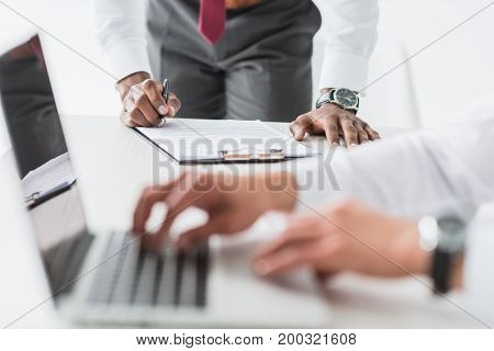 African American Businessman Signing Contract