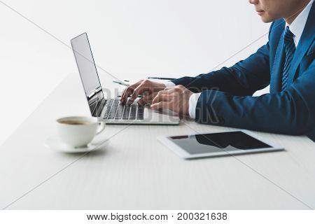 Businessman Typing On Laptop At Workplace