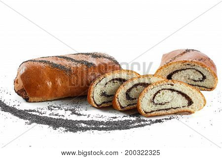 Delicious sliced cake with poppy filling isolated on white copyspace.
