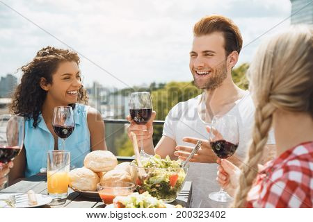 Group of people having barbecue party eating