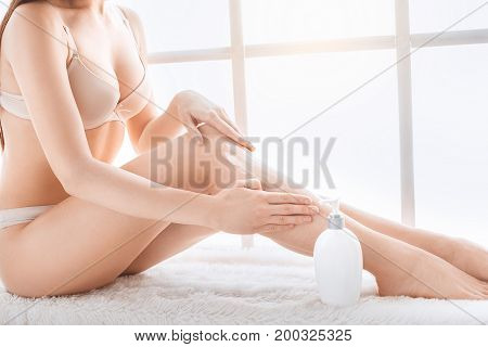 Young female body care at home lotion