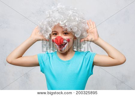 Little child wearing clown costume birthday celebration grimase