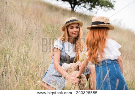 Mother And Daughter In Straw Hats