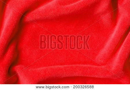 Closeup of red draped velvet textile for background