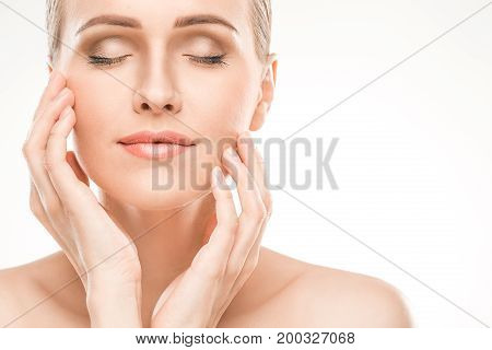 Mature female beauty health care studiio portrait smiling