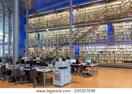 DELFT THE NETHERLANDS - AUGUST 19 2017: Students at work in the Library of the Technical University Delft The Netherlands