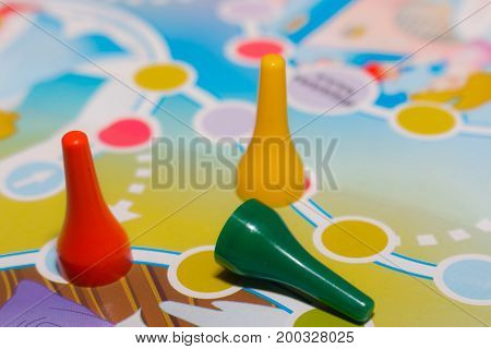 Blue yellow and red plastic chips dice and Board games for children .