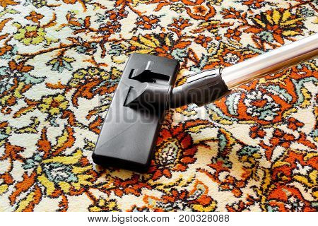 Cleaning Old Carpet With A Vacuum Cleaner Universal Nozzle Close-up.