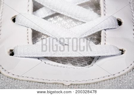 Sports shoes of laces close up background