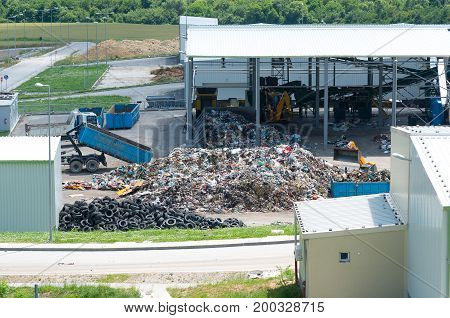 Waste treatment plant depot. Urban landfill. Recovery concept