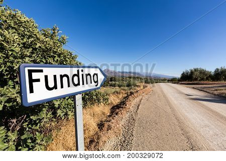 Humorous sign for start up company looking for venture capital funding of their business with sign pointing to desert