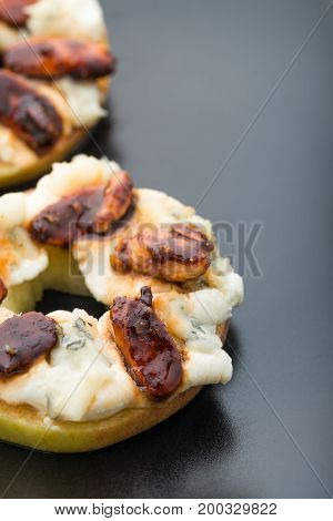 Apple Circles With Cream Cheese, Gorgonzola And Spicy Almond Nuts With Honey. Dark Background