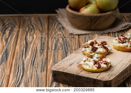Apple Circles With Cream Cheese, Gorgonzola And Spicy Almond Nuts With Honey. Rustic Wooden Table