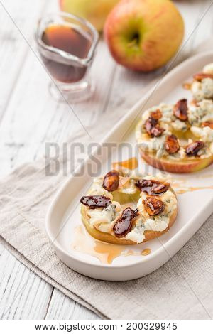Apple Circles With Cream Cheese, Gorgonzola And Spicy Almond Nuts With Honey. Rustic White Wooden Ta