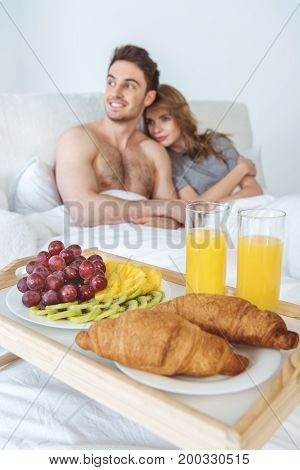 Couple With Breakfast In Bed