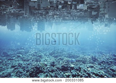 Abstract upside-down city and water ocean sea backdrop with copy space. Creativity abstraction and innovation concept