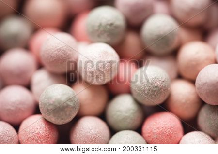 Makeup powder balls close up. Selective focus.
