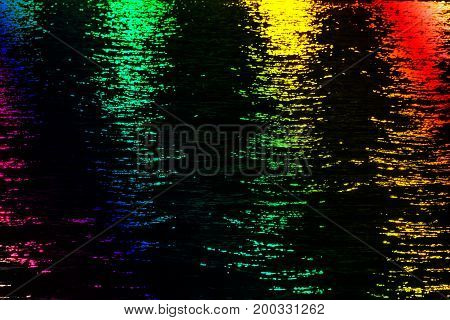 Light rays reflected on a water surface in motion.