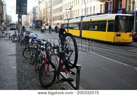 German People Biking Bicycle And Lock Bike At Bicycle Parking Beside Road For Go To Passenger Tramwa