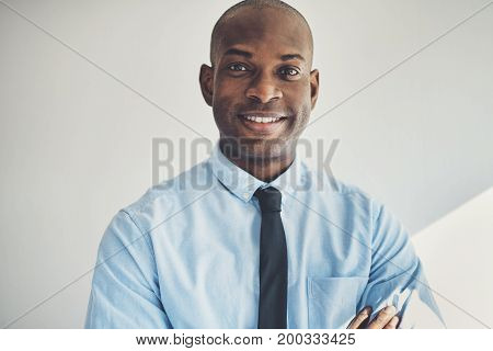 Mature Businessman Standing With His Arms Crossed In An Office