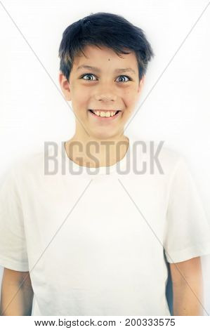 Good boy smiling directly into the camera. He has very good eyes and healthy teeth. A boy standing on a white background. Isolated