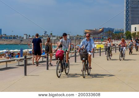 Barcelona, Spain - July 15, 2016 : People rest on beach in the area Pablenou. Barcelona. Spain