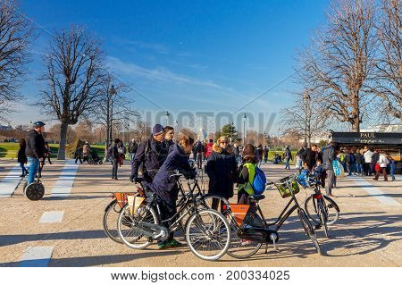 Paris, France - December 27, 2016 : Vacationers and tourists in the garden of the Tuileries. Paris. France