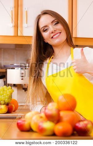 Female Cook Working In Kitchen.