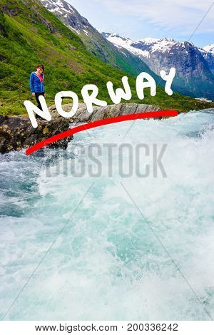 Travel beauty in nature. Tourist woman looking at Videfossen (called Buldrefossen) waterfall in Norway Sogn og Fjordane