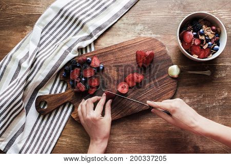 Woman Cutting Berries