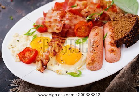 English Breakfast - Fried Egg, Sausage, Tomatoes, Bacon And Toast.
