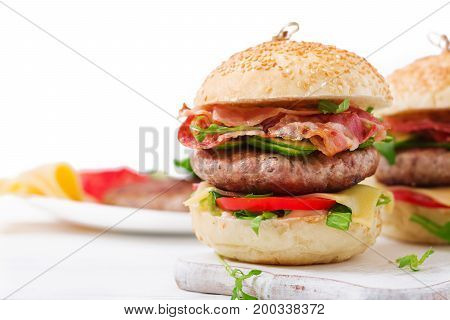 Big Sandwich - Hamburger Burger With Beef, Cheese, Tomato, Cucumber And Fried Bacon.