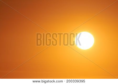 The sun can be seen in the cloudless sky.