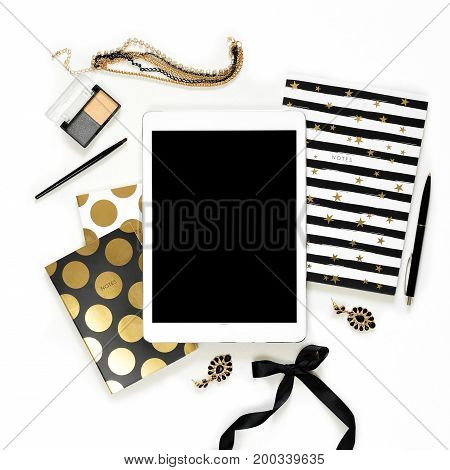 Flat Lay Fashion Feminine Home Office Workspace With Tablet, Stylish Black Gold Notebooks, Cosmetics