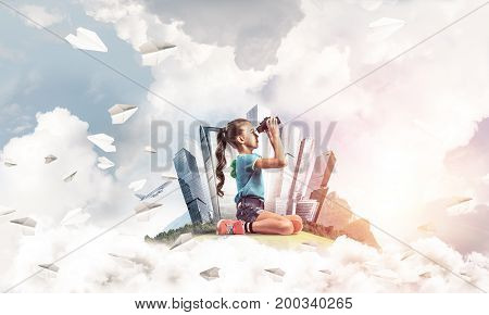 Cute kid girl on city floating island looking in binoculars