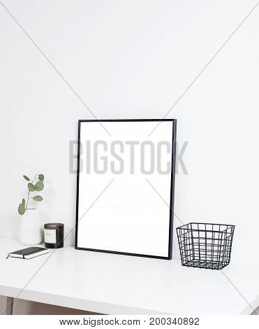 Minimalist white office interior, stylish work table space with poster artwork mockup.
