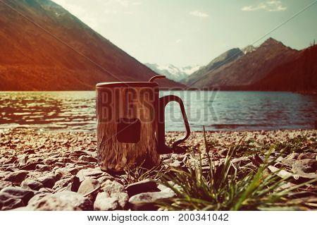 Tea Bag In Orange Plastic Cup.