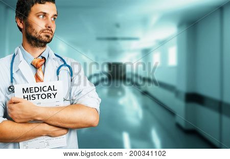 People Care Insurance Medicine Concept. Male Doctor with Medical History