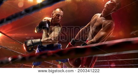 Boxer athlete in action. boxing ring. water drops and blood in face. Red tonning