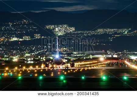 OSAKA, JAPAN - AUG. 13, 2017: Boeing 737-800 taking off from the Itami International Airport in Osaka, Japan in the night.