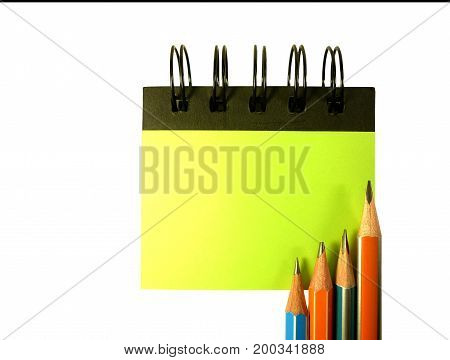 notebook on pencil isolated on white background