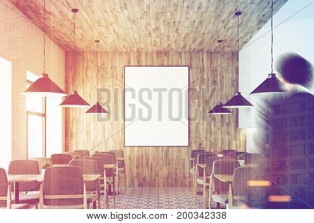 People in a white cafe interior with a wooden wall and ceiling a vertical framed poster on a wall wooden tables with gray chairs. 3d rendering mock up toned image