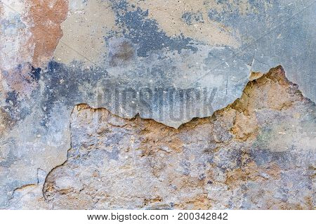background texture old wall with remnants of varicoloured plasters