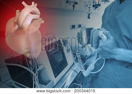 doctor use EKG or ECG and test defibrillator system care heart in emergency room