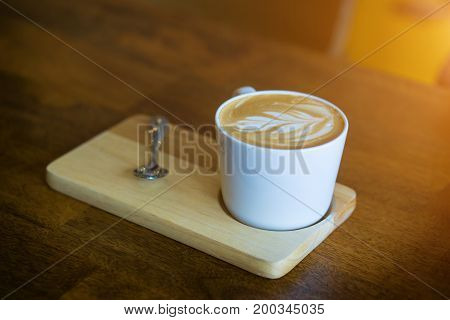 Hot Latte Coffee On Wooden Table.