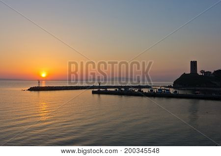 Sunrise at a little fishing harbour in Chalkidiki, Greece