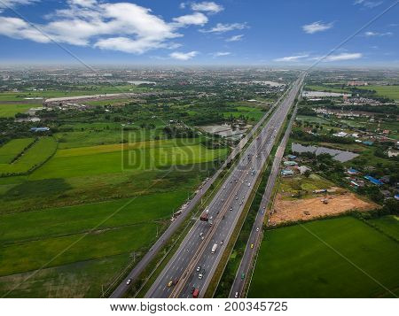 Aerial View Of Rural Tree Covered Countryside With Highway Road, Top View Photo From Drone.
