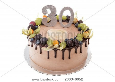 Chocolate birthday cake for a man. On a white background with berries.